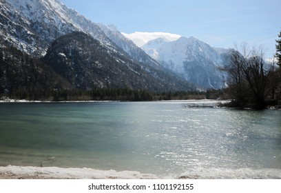 awesome alpine little lake called Predil Lake Northern Italy near Tarvisio Town with long exposition thecnique