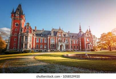 Awesome Autumn Landscape during sunset with colorful sky. Amazing view on Palace in Plawniowice in Autumn. Upper Silesia, Poland. Fantastic Creative image with Fairytale castle. Postcard.