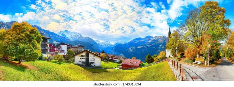 Awesome autumn view of picturesque alpine village Wengen.  Sunny morning scene of Swiss Alps. Location: Wengen village, Berner Oberland, Switzerland, Europe.