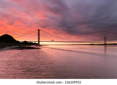 Awesome blood red, hellish sunrise over the Humber Bridge (UK)