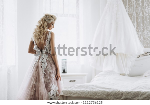 Awesome bride's wedding preparations and wedding dress