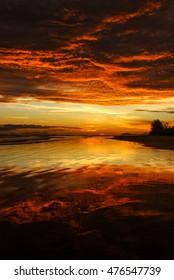 Awesome bright colorful sunrise over the sea. Borneo, Kalimantan, Sematan, Malaysia .