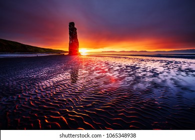 Awesome dark sand after the tide. Location place famous Hvitserkur, Vatnsnes peninsula, Iceland, Europe. Amazing scene. Scenic image of beautiful nature landscape. Discover the beauty of earth.