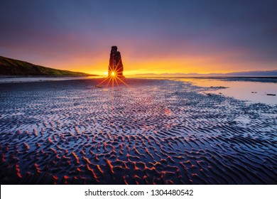 Awesome dark sand after the tide. Location place famous Hvitserkur, Vatnsnes peninsula, Iceland, Europe. Fabulous scene. Scenic image of most popular tourist attraction. Discover the beauty of earth.
