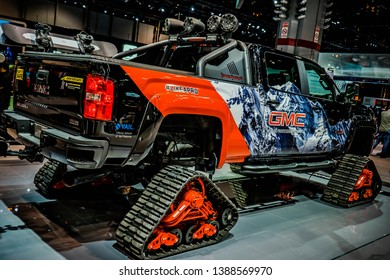 Awesome GMC truck with Cterpillar track exposition on Chicago Autoshow 02/17/2019