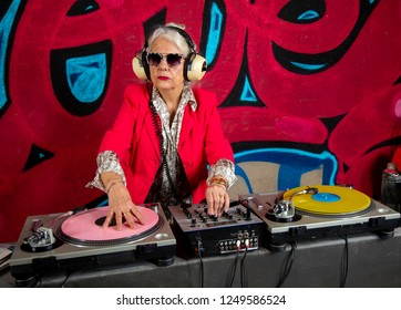 awesome grandma dj in front of graffiti wall