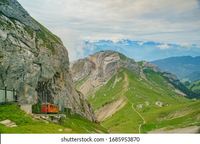 Awesome landscape with the red train over Mount Pilatus, Lucerne, Switzerland