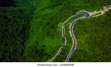 An awesome loop in the Hai Van Pass, Da Nang, Vietnam. A beautiful road to drive by motorbike, very nice curves, turns and awesome view. Aerial view.