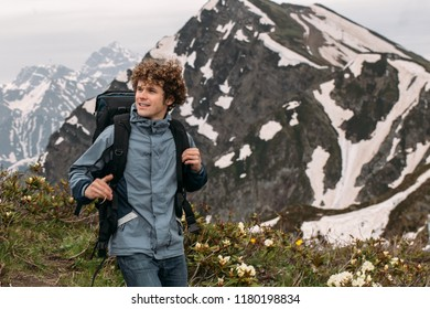 awesome man is hiking over difficult terrain. close up photo. copy space