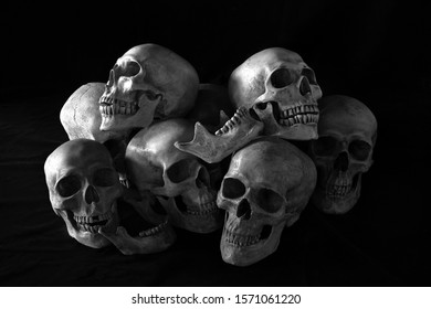 Awesome, pile of skull and bone, on black background and black cloth floor, Still Life style and adjustment color black and white for background