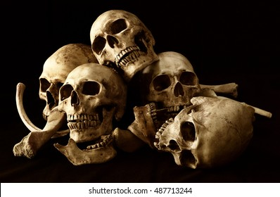 Awesome pile of skull and bone on brown cloth background, Still Life style, selective focus, Adjustment color for background