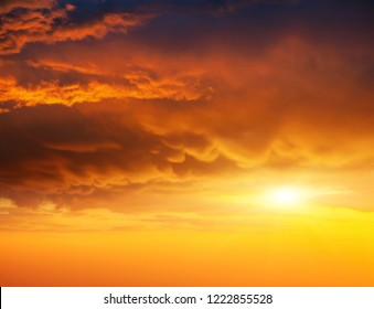 Awesome red vivid clouds illuminated by the beams of the sun. Scenic image of textured sky. Ecology concept - climate change in the environment. Spectacular wallpaper. Discover the beauty of earth.