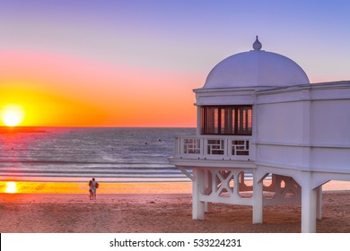 Awesome Romantic Sunset in Cadiz beach. Old seaside resort on the beach in Cadiz. Andalusia, Spain