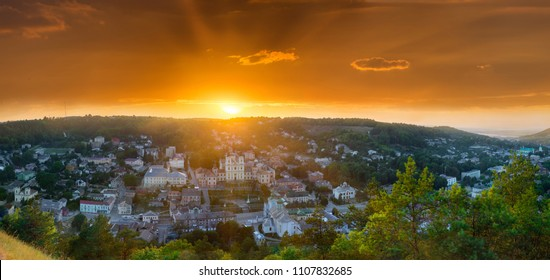 Awesome stunning evening sunset in backlit sunbeam orange sky. Aerial panoramic view from the Bona mountain. Cityscape ancient town Kremenets, Ternopil region, Ukraine.