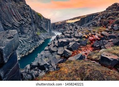 Awesome summer view of Studlagil Canyon. Majestic morning landscape of Jokulsa A Bru river. Spectacular outdoor scene of Iceland, Europe. Beauty of nature concept background.