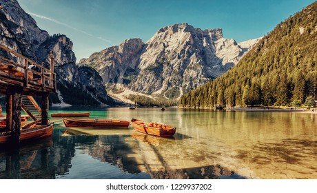 Awesome Sunny nature landscape. Impressively beautiful lake Braies  at sunrise. best popular location for photographer in Dolomites Alps. view on Impressive lake with turquoise water and boats.