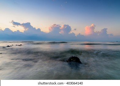 Awesome sunrise with marvelous clouds at Black Stone Beach, Kuantan, Malaysia.