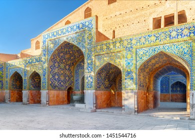 Awesome view of courtyard of the Shah Mosque (Imam Mosque) in Isfahan, Iran. Walls and arches covered with colorful mosaic tiles. Persian exterior of the Muslim place. Amazing Islamic architecture.