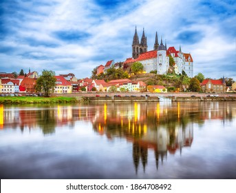 Awesome view on Albrechtsburg castle and cathedral on the River Elbe with dramatic  sunset.  Location: Meissen, Saxony, Germany, Europe.