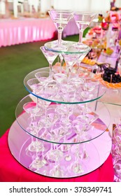 Awesome wedding reception of food and drink with various pink light, pyramid glasses