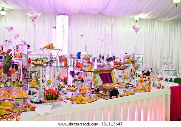 Awesome wedding reception of food and drink with various pink light