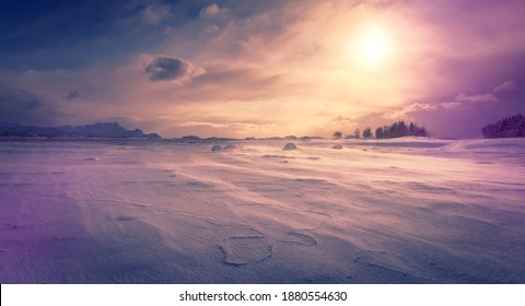 Awesome Winter Scenery. Wonderful wintry valley with snow-cowered river during sunset. Frosty morning with Snowfall and wind. Amazing nature background. Toned creative image. Norway. Lofoten islands