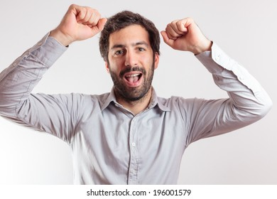 awesome Young man give the hands up, expressing positivity, isolated on white