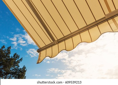 awning against blue sunny sky