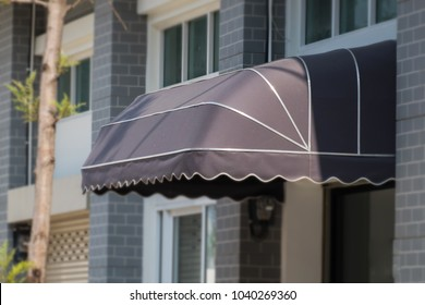 awning mounted on the front door of the shop.