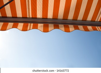 Awning over bright sunny blue sky. There  also is a vector of this image in my portfolio