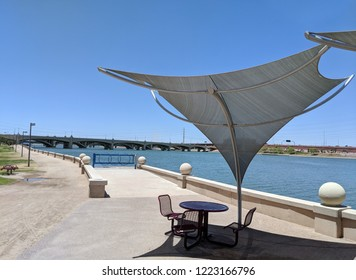 Awnings shielding recreation area from merciless hot sun at Salt River lakeside in Tempe, Arizona