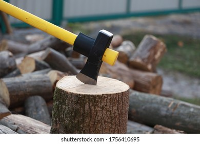 Ax stuck in the stump. wooden stump in the forest. Deforestation man. Felled tree. Woodcutter's ax on the stump.