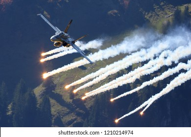 AXALP, SWITZERLAND - OCTOBER 10, 2018: McDonnell Douglas F/A-18C Hornet multirole jet fighter of Swiss air force perfoms demonstration flight during Axalp 2018 airshow at shooting range in Swiss Alps.