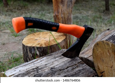 The axe cuts a tree. Axe is a tool for wood harvesting.Toport consists of handle and blade.
