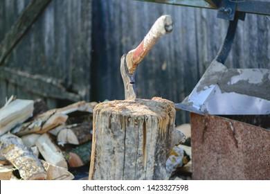 Axe on stump. Vintage axe. Old chopping axe on wooden stump.