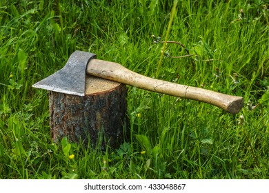 Axe on the stump. Work logger tool. Firewood for the winter