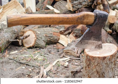 Axe in stump. Axe ready for cutting timber.Woodworking tool. Lumberjack axe in wood, chopping timber. Travel, adventure, camping gear