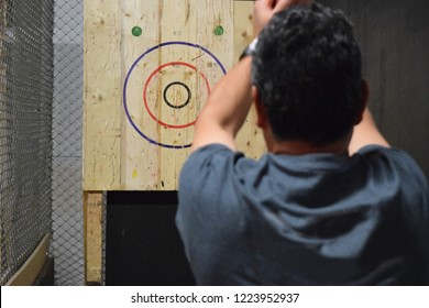 Axe throwing hall for recreation, competition, leagues and team building. Image ideal for poster, events, design and layout with room for text, information etc, on the sides.