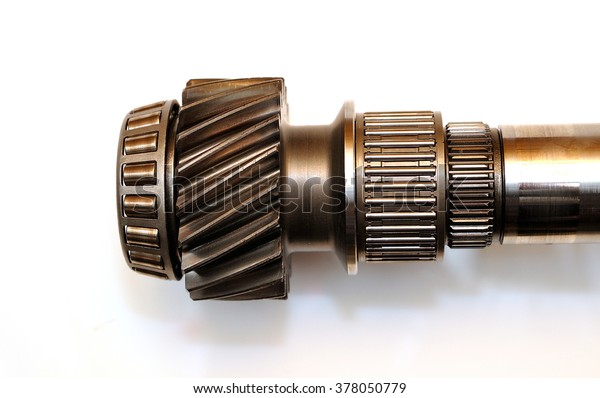 Axle from a car gearbox isolated on white background.