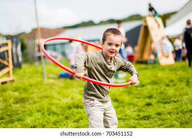 AXMINSTER, DEVON, UK - AUGUST 27 - A child plays at River Cottage's annual music and food festival