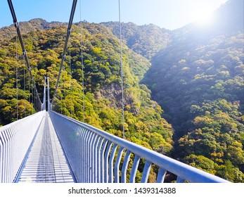 The Aya Teruha Large Suspension Bridge, a biggest pedestrian suspension bridge in Japan that have 142 meters heights from the Aya River Valley in Miyazaki Province, viewing inside the bridge walkway.