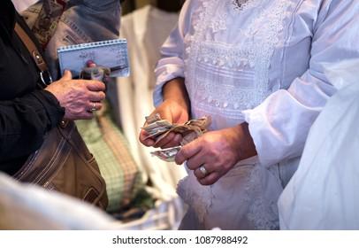 AYACUCHO - PERU - CIRCA 2018: Hands of  unidentified women with money in the market of Ayacucho, circa 2018.
