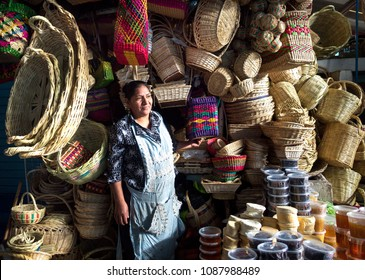 AYACUCHO - PERU - CIRCA 2018: Portrait of a unidentified with baskets woman in the market of Ayacucho, circa 2018.