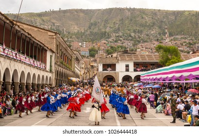 AYACUCHO, PERU - FEBRUARY 10, 2018. A large group of women sing and dance their way by the main square of Ayacucho.