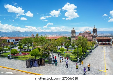 AYACUCHO, PERU - NOVEMBER 4: People passing through the Plaza de Armas in Ayacucho, Peru on November 4, 2014