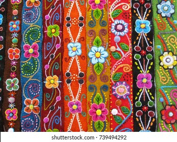 Ayacucho, Peru, October 01, 2011 : Colorful Peruvian handicraft embroidered flowers on textile