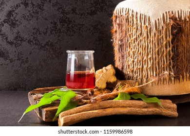 Ayahuasca brew with shamanic drum and medicinal herbs.