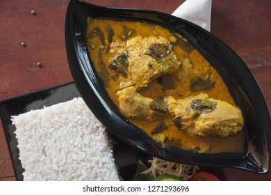 ayam kemangi or chicken basil, is an indonesia traditional food made from chicken soaked with herb and spices, presenting with rise, bean sprouts, tomato, cucumber, carot and long beans as vegetable