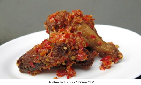 Ayam rica or spicy chicken manado food, grey wall background