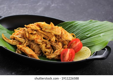 Ayam Sisit or Ayam Suwir is a Balinese Cuisine Made from Spicy Chunks of Chicken Meat, Served on Black Plate. Copy Space for Text
